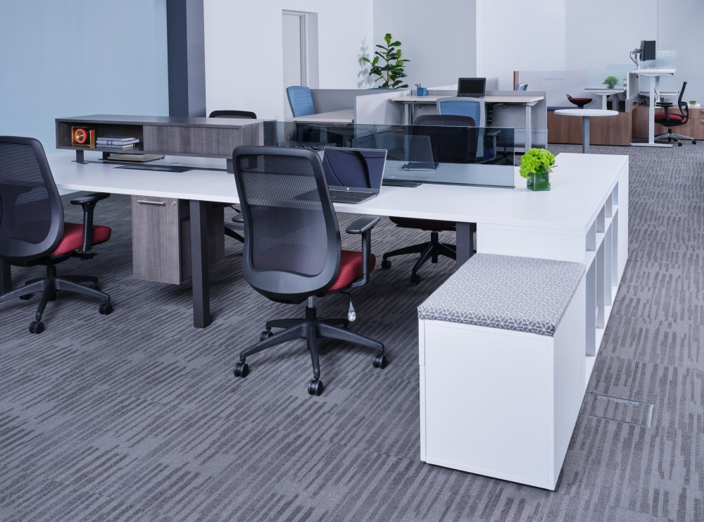 Preview of Oxygen Benching with glass screen, worksurface mounted storage, and suspended pedestal. Shown with Bolton Seating