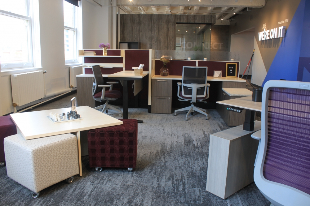 Preview of NeoCon 18 Divi Workstations with Height Adjustablility and Devens Task seating. Also shown with Volker Cubes and Nesting Table.