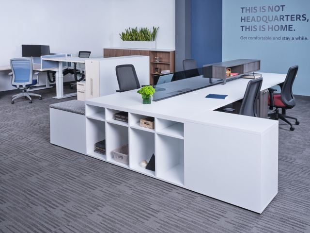 Oxygen Benching with glass screen and worksurface mounted storage. Shown with Bolton Seating