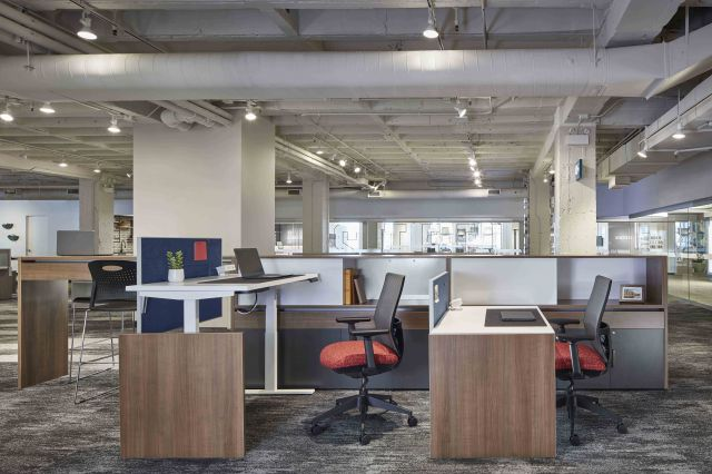 Calibrate Community with Height Adjustable Tables and Standing Height Spine