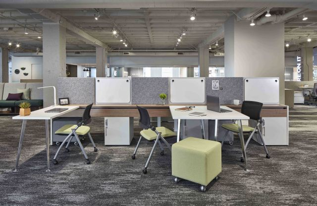 Calibrate Community Benching with Worksurfaces pushed together via the bench glide system for impromptu meetings