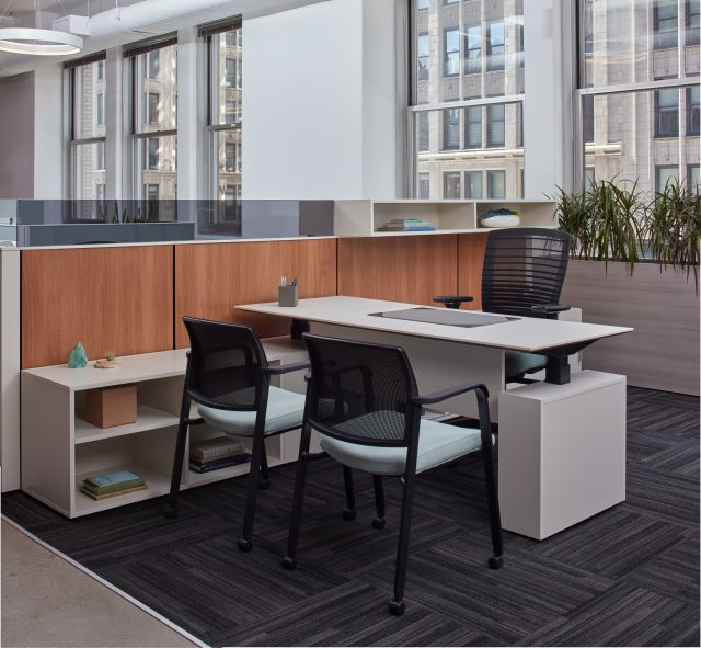 Height Adjustable Desk with Natick Task Seating, Paxton Side Seating against Matrix Laminate Panels