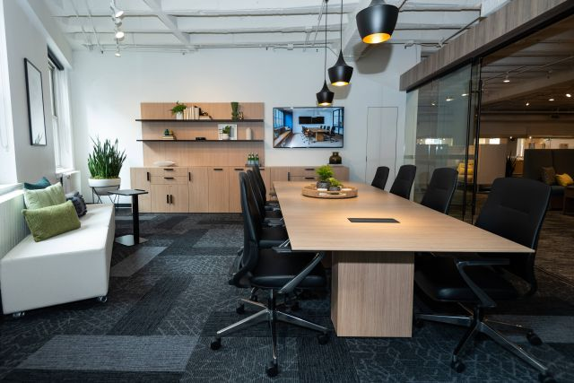 NeoCon 2021 Calibrate Conferencing with Auburn Conference Seating, Calibrate Storage and L Shelves, LB Mobile Ottomans and Laptop Table
