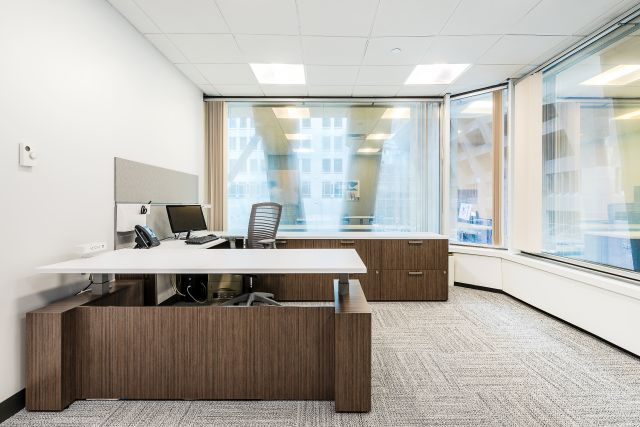 Client Space with Calibrate Series Casegoods Height Adjustable Desk and Natick Seating
