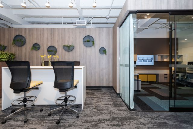 NeoCon 2021 Calibrate End Panel Table and Upton Stools. Calibrate Community Shared Office with Sliding Worksurfaces