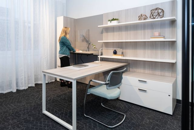 NeoCon 2021 Calibrate Casegoods Private Office with height adjustable cantilevered return and L Shelves. Shown with Devens side chair