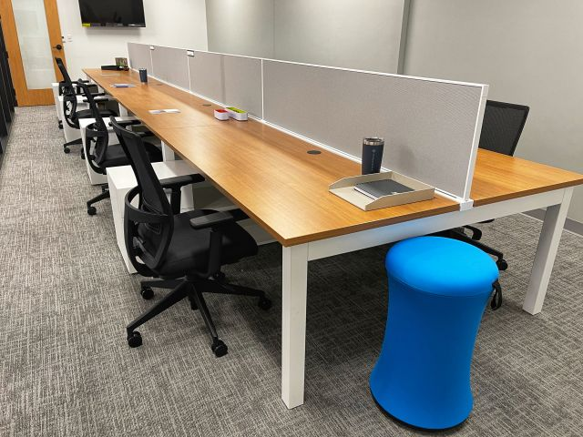 Client Site Oxygen Benching with Fabric Spine Screens, Calibrate Storage, Sulli Stools and Devens Task Seating