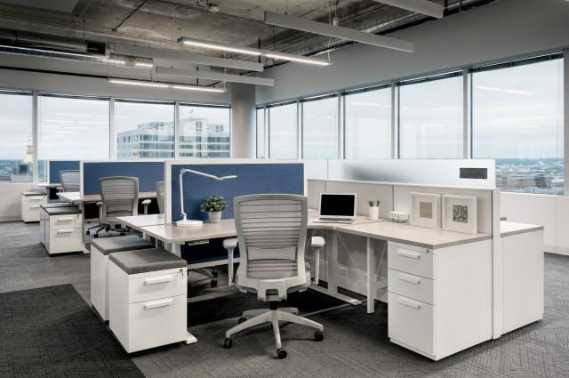 Client Space with Matrix, Height Adjustable Worksurfaces and Privacy Screens, L Series Storage and Natick Seating