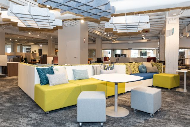 NeoCon 2021 Welcome Area with Custom PET Clouds suspended from ceiling, LB backless against LB Lounge Couch with 3 sides. Shown with Volker stools, Day-to-Day Disc Base Table, and Laptop Table