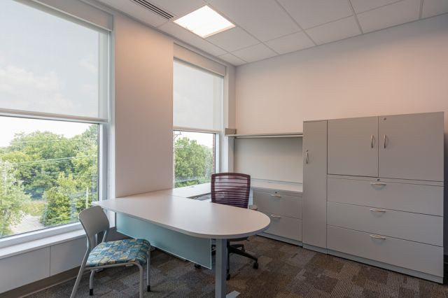 Client Site, Private Office with d-top freestanding table, height adjustablereturn and L Series steel storage, Pierce and Natick seating